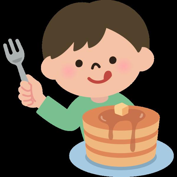 Boy eating pancakes