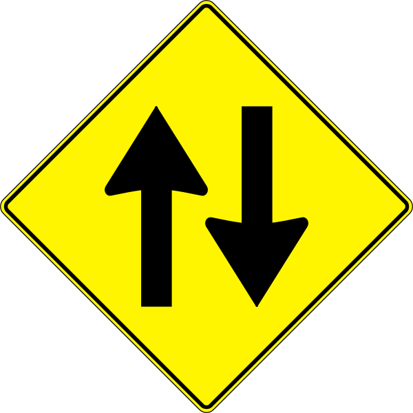yellow road sign - two way traffic