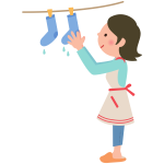 Woman hanging out laundry on the clothesline